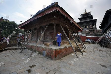 A Nepalese Woman Sweeps a Half Damaged Temple a Remnant of the April Earthquake at Kathmandu Durbar Square in Kathmandu Nepal 20 September 2015 Nepal's President Ram Baran Yadav is Enacting the New Constitution During Aspecial Function at the Constitution Assembly Hall in Kathmandu on 20 September 2015 Nepal Kathmandu