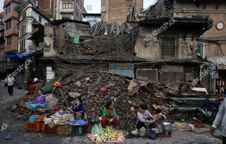 Nepalese Vendors Wait For Customers in Front of a Collapsed House a Remnant of the April Earthquake in Kathmandu Nepal 20 September 2015 Nepal's President Ram Baran Yadav is Enacting the New Constitution During Aspecial Function at the Constitution Assembly Hall in Kathmandu on 20 September 2015 Nepal Kathmandu