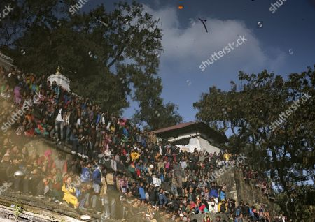 Stock Picture of Nepalese Blurred by the Heat of a Fire Gather to Pay Their Last Tribute to Late Nepalese Prime Minister Sushil Koirala at Pashupati Cremation Center in Kathmandu Nepal 10 February 2016 Former Prime Minister and Nepali Congress President Sushil Koirala Passed Away on 09 February 2016 at the Age of 76 Succumbing to Pneumonia According to Local News Reports Nepal Kathmandu