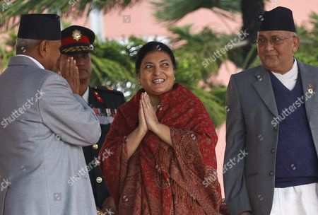 Stock Photo of Nepal's First Elected Female President Bidhya Bhandari (c) is Congratulated by Outgoing President Ram Baran Yadav (l) While Prime Minister Kp Sharma Oli (r) Looks on After Taking Her Oath in a Ceremony at the Presidential Office in Kathmandu Nepal 29 October 2015 Bhandari who is the Widow of the Deceased Chairman of the Communist Party of Nepal-unified Marxist-leninist (uml) Madan Bhandari Won 327 Votes to Beat Her Competitor Kulbahadur Gurung who Got 214 Votes to Secure the Largely Ceremonial Post Nepal Kathmandu