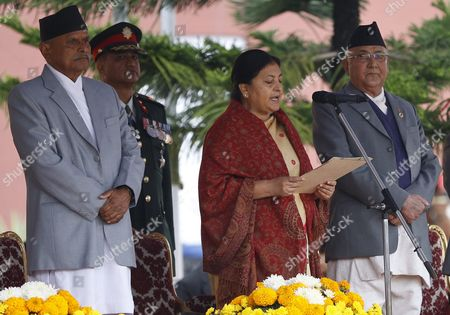 Nepal's First Elected Female President Bidhya Bhandari (c) is Flanked by Outgoing President Ram Baran Yadav (l) and Prime Minister Kp Sharma Oli (r) As She Takes Her Oath at the Presidential Office in Kathmandu Nepal 29 October 2015 Bhandari who is the Widow of the Deceased Chairman of the Communist Party of Nepal-unified Marxist-leninist (uml) Madan Bhandari Won 327 Votes to Beat Her Competitor Kulbahadur Gurung who Got 214 Votes to Secure the Largely Ceremonial Post Nepal Kathmandu