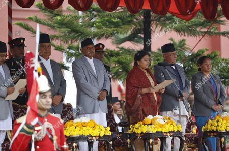 Stock Picture of Nepal's First Elected Female President Bidhya Bhandari (3-r) Takes Her Oath of Office While Outgoing President Ram Baran Yadav (3-l) Prime Minister Kp Sharma Oli (2-r) and Speaker of Parliament Onsari Gharti Magar (r) Join the Ceremony at the Presidential Office in Kathmandu Nepal 29 October 2015 Bhandari who is the Widow of the Deceased Chairman of the Communist Party of Nepal-unified Marxist-leninist (uml) Madan Bhandari Won 327 Votes to Beat Her Competitor Kulbahadur Gurung who Got 214 Votes to Secure the Largely Ceremonial Post Nepal Kathmandu