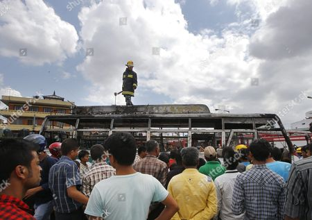 Nepalese Firefighters Extinguish a Fire After Anti-constitution Protestors Set a Passenger Bus on in Kathmandu Nepal 20 September 2015 Several Ethnic Communities of Nepal Including Newar Madeshi and Tharu Are Protesting Against the New Constitution Saying This Constitution Will not End Their Discrimination Nepal President Ram Baran Yadav is Enacting the New Constitution During a Special Function at the Constitution Assembly Hall in Kathmandu on 20 September 2015 Nepal Kathmandu