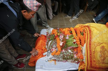A Man Pays His Respects to Late Nepalese Prime Minister Sushil Koirala by Touching His Feet at His Private Residence in Kathmandu Nepal 09 February 2016 Former Prime Minister and Nepali Congress President Sushil Koirala Passed Away on 09 February 2016 at the Age of 76 Succumbing to Pneumonia According to Local News Reports Nepal Kathmandu