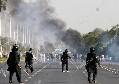 Policemen Fire Tear Gas Shells to Disperse the People who Are Marching Towards the Parliament During a Protest on the Chehlum (the Fortieth Day) of Execution of Mumtaz Qadri in Islamabad Pakistan 27 March 2016 Pakistan Had on 29 February Hanged Mumtaz Qadri the Ex-police Guard who Killed Salman Taseer a Former Governor For Opposing the Country's Blasphemy Laws Which Impose the Death Penalty in Some Cases Pakistan Islamabad