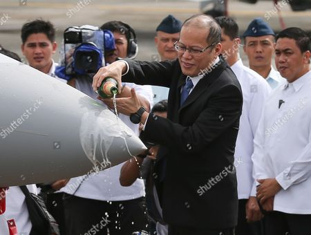 Philippines' President Benigno S Aquino Iii (c) Pours Champagne on a Fa-50ph Aircraft During a Joint Turn-over and Blessing Ceremony of Newly Acquired Assets of the Philippine Air Force at the Villamor Air Base in Pasay City South of Manila Philippines 05 December 2015 the Philippine Air Force Has not Had Fighter Jets For a Decade But the Government Has Been Building Up the Military's Capability Amid Increasing Tensions with Beijing Over Territorial Disputes in the South China Sea Among the Air Assets Turned Over Were Two Fa-50ph Aircraft One C295m Aircraft and Six Aw-109e Helicopters Philippines Pasay City