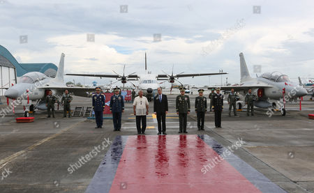 (l-r) Philippine National Police Chief Ricardo Marquez Philippine Air Force Commanding General Jeffrey Delgado Secretary of Defence Voltaire Gazmin President Benigno S Aquino Iii Armed Forces of the Philippines Chief Hernando Irriberi Philippine Army Comander Eduardo Ano and Navy Chief Ceasar Taccad Lead the Joint Turn-over and Blessing Ceremony of Newly Acquired Assets of the Philippine Air Force at the Villamor Air Base in Pasay City South of Manila Philippines 05 December 2015 the Philippine Air Force Has not Had Fighter Jets For a Decade But the Government Has Been Building Up the Military's Capability Amid Increasing Tensions with Beijing Over Territorial Disputes in the South China Sea Among the Air Assets Turned Over Were Two Fa-50ph Aircraft One C295m Aircraft and Six Aw-109e Helicopters Philippines Pasay City