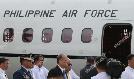 Philippines President Benigno S Aquino Iii (c) with Military Officials Walks Past a C295m Aircraft During a Joint Turn-over and Blessing Ceremony of Newly Acquired Assets of the Philippine Air Force at the Villamor Air Base in Pasay City South of Manila Philippines 05 December 2015 the Philippine Air Force Has not Had Fighter Jets For a Decade But the Government Has Been Building Up the Military's Capability Amid Increasing Tensions with Beijing Over Territorial Disputes in the South China Sea Among the Air Assets Turned Over Were Two Fa-50ph Aircraft One C295m Aircraft and Six Aw-109e Helicopters Philippines Pasay City