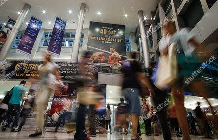 An Image Taken with a Slow Shutter Speed Shows Filipino Walking Along a Giant Poster Celebrating 40 Years of the Heavyweight Boxing Bout Between Muhammad Ali and Joe Frazier in 1975 Dubbed 'Thrilla in Manila' at the Araneta Coliseum in Quezon City Northeast of Manila Philippines 04 June 2016 Born Cassius Clay Boxing Legend Muhammad Ali Dubbed As 'The Greatest ' Died on 03 June 2016 in Phoenix Arizona Usa at the Age of 74 a Family Spokesman Said Philippines Quezon