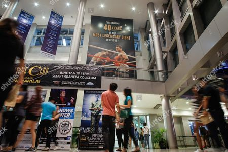 A Filipino Couple Looks a Giant Poster Celebrating 40 Years of the Heavyweight Boxing Bout Between Muhammad Ali and Joe Frazier in 1975 Dubbed 'Thrilla in Manila' at the Araneta Coliseum in Quezon City Northeast of Manila Philippines 04 June 2016 Born Cassius Clay Boxing Legend Muhammad Ali Dubbed As 'The Greatest ' Died on 03 June 2016 in Phoenix Arizona Usa at the Age of 74 a Family Spokesman Said Philippines Quezon