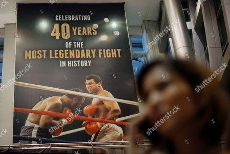 A Filipino Uses Her Mobile Phone Next to a Giant Poster Celebrating 40 Years of the Heavyweight Boxing Bout Between Muhammad Ali and Joe Frazier in 1975 Dubbed 'Thrilla in Manila' at the Araneta Coliseum in Quezon City Northeast of Manila Philippines 04 June 2016 Born Cassius Clay Boxing Legend Muhammad Ali Dubbed As 'The Greatest ' Died on 03 June 2016 in Phoenix Arizona Usa at the Age of 74 a Family Spokesman Said Philippines Quezon