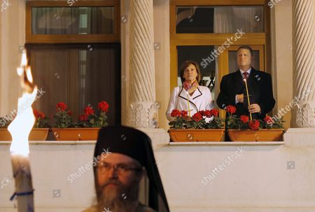 Romania's President Klaus Iohannis (r) and His Wife Carmen Johannis (l) Hold Candles While Attending the Easter Mass in Front of the Orthodox Cathedral in Bucharest Romania Late 30 April 2016 Thousands of Believers Gathered to Celebrate the Traditional Orthodox Easter Mass at the Cathedral Romania Bucharest
