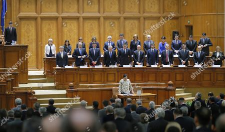 Designated Romanian Prime Minister Dacian Ciolos (3-l) Together with His Cabinet Members Pays Respect For the Victims of the Paris Terror Attacks in a Moment of Silence Before Addressing Lawmakers During the Validation Vote Session Held at Parliament Palace in Bucharest Romania 17 November 2015 Ciolos 46 who Served As Eu Agriculture Commissioner Since 2010 was Appointed by Romania's President Klaus Iohannis After Victor Ponta Resigned to Form a Technocratic Government to Rule the Country Until Elections Next Year Romania Bucharest
