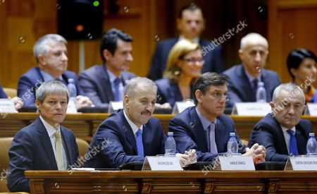 Designated Romanian Prime Minister Dacian Ciolos (l) Together with His Cabinet Members Looks on Before Address Lawmakers During the Validation Vote Session Held at Parliament Palace in Bucharest Romania 17 November 2015 Ciolos 46 who Served As Eu Agriculture Commissioner Since 2010 was Appointed by Romania's President Klaus Iohannis After Victor Ponta Resigned to Form a Technocratic Government to Rule the Country Until Elections Next Year Romania Bucharest