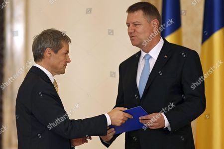 Romanian New Prime Minister Dacian Ciolos (l) is Congratulated by Romania's President Klaus Iohannis (r) After the Swearing in Ceremony Held at the Presidential Palace in Bucharest Romania 17 November 2015 Ciolos 46 who Served As Eu Agriculture Commissioner Since 2010 was Nominated As Prime Minister by Romania's President Klaus Iohannis After Victor Ponta Resigned to Form a Technocratic Governemnt to Rule the Country Until Elections Next Year Romania Bucharest