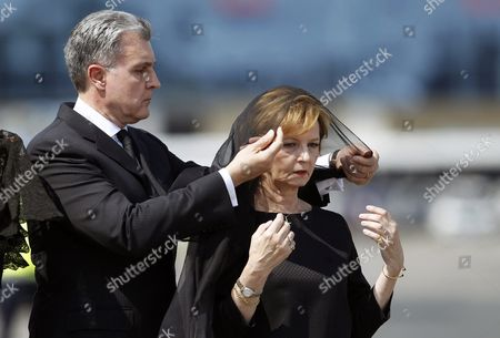 Prince Radu of Romania (l) Arranges the Scarf of His Wife Princess Margareta of Romania Daugter of Romania's Former King Michael and Queen Anne During a Ceremony Upon the Arrival of Her Mother's Coffin at the Otopeni International Airport Near Bucharest Romania 09 August 2016 Queen Anne Wife of Romania's Former King Michael Died Aged 92 at a Hospital in Switzerland on 01 August 2016 Born Princess Anne of Bourbon-parma She Met Michael in 1947 and Married Him in 1948 Romania Bucharest