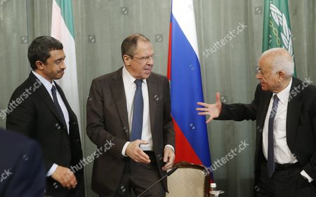 Russian Foreign Minister Sergei Lavrov (c) Shakes Hands with Arab League Secretary General Nabil Al-arabi (r) While the United Arab Emirates' Foreign Minister Sheikh Abdullah Bin Zayed Al Nhayan (l) Looks on During Their Joint News Conference Following a Session of the Russian-arabic Forum of Cooperation in Moscow Russia 26 February 2016 Russian Federation Moscow