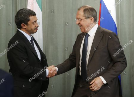 Russian Foreign Minister Sergei Lavrov (r) Shakes Hands with the United Arab Emirates' Foreign Minister Sheikh Abdullah Bin Zayed Al Nhayan (l) During Their Joint News Conference with Arab League Secretary General Nabil Al-arabi (unseen) Following a Session of the Russian-arabic Forum of Cooperation in Moscow Russia 26 February 2016 Russian Federation Moscow