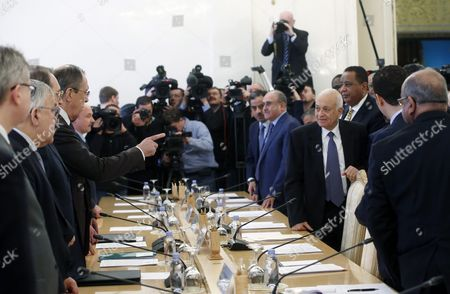 Stock Photo of Russian Foreign Minister Sergei Lavrov (4-l) Points out While Speaking to Arab League Secretary General Nabil Al-arabi (3-r) As Prepare to Sit Down For a Session of the Russian-arabic Forum of Cooperation in Moscow Russia 26 February 2016 Others Are not Identified Russian Federation Moscow