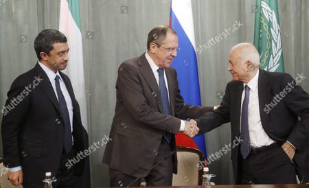 Stock Image of Russian Foreign Minister Sergei Lavrov (c) Shakes Hands with Arab League Secretary General Nabil Al-arabi (r) While the United Arab Emirates' Foreign Minister Sheikh Abdullah Bin Zayed Al Nhayan (l) Looks on During Their Joint News Conference Following a Session of the Russian-arabic Forum of Cooperation in Moscow Russia 26 February 2016 Russian Federation Moscow
