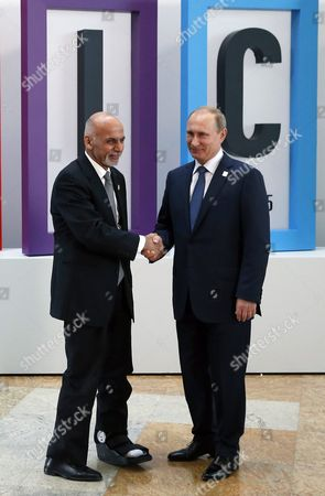 Russian President Vladimir Putin (r) Welcomes President of the Islamic Republic of Afghanistan Ashraf Ghani Ahmadzai (l) at the Brics Summit in Ufa the Capital of Bashkortostan Republic Russia 09 July 2015 Ufa is Hosting Brics (brazil Russia India China and South Africa) and Sco (shanghai Cooperation Organisation) Summits on 09 and 10 July Russian Federation Ufa