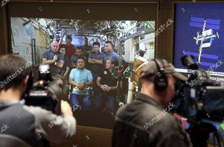 Stock Photo of A Screen of the Russian Mission Control Center Shows Live Television of the International Space Station Crew Members As They Take Part in the News Conference Town of Korolev Outside Moscow Russia 08 September 2015 (l-r) Us Astronaut Scott Kelly Japanese Astronaut Kimiya Yui Russian Cosmonaut Gennady Padalka Russian Cosmonaut Sergei Volkov Kazakhstan Cosmonaut Aydyn Aimbetov Russian Cosmonaut Mikhail Korniyenko Russian Cosmonaut Oleg Kononenko Us Astronaut Kjell Norwood Lindgren and Denmark's First Man in Space Astronaut Andreas Mogensen Russian Federation Korolev