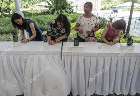 Four Women Write Tribute Notes at a Memorial Area Set Up For the Passing of Sr Nathan Outside the Istana Presidential Palace in Singapore 23 August 2016 Nathan who was Singapore's Sixth President Died in a Hospital on 22 August 2016 at the Age of 92 a State Funeral Will Be Held on Friday and His Body Will Lie in State at the Parliament House For the Public to Pay Their Last Respects on Thursday Singapore Singapore