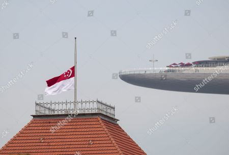 Stock Picture of The Singapore Flag Flies at Half Mast Over the Parliament House (l) with the Marina Bay Sands Sky Park in the Background in Singapore 23 August 2016 Sr Nathan Singapore's Sixht President Died in Hospital on 22 August 2016 at the Age of 92 a State Funeral Will Be Held on 26 August and His Body Will Lie in State at the Parliament House For the Public to Pay Their Last Respects on 25 August Singapore Singapore