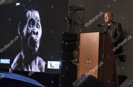 Professor Lee Berger (r) From the University of the Witwatersrand with an Artists' View of New Human Relative 'Homo Naledi' (l) at a Media Event in Johannesburg South Africa 10 September 2015 the New Species was Announced by an International Team of More Than 60 Scientists Led by Lee R Berger the Species Name H Naledi is Taken From Name of the Cave where the Bones where Found Naledi Means 'Star' in the Local Sesotho Language South Africa Johannesburg