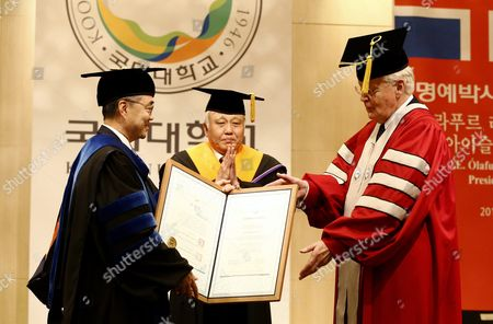 Icelandic President Olafur Ragnar Grimsson (r) Receives a Doctor of Philosophy Honoris Causa From Kookmin University President Yu Ji-soo (l) During a Ceremony at Kookmin University in Seoul South Korea 09 November 2015 President Olafur Ragnar Grimsson is in Seoul on a Three-day Official Visit to Promote Cooperation Between the Two Countries Korea, Republic of Seoul