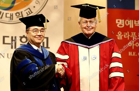 Icelandic President Olafur Ragnar Grimsson (r) Poses For a Photo with Kookmin University President Yu Ji-soo (l) After Receiving a Doctor of Philosophy Honoris Causa at Kookmin University in Seoul South Korea 09 November 2015 President Olafur Ragnar Grimsson is in Seoul on a Three-day Official Visit to Promote Cooperation Between the Two Countries Korea, Republic of Seoul