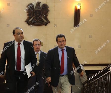 Jean-frederic Poisson (r) a Member of the National Assembly of France and Member of the Christian Democratic Party and Benjaman Platshard (c) the President of the French Organization For the Middle Easts Christians Walking with an Unidentified Man For a Meeting with Syrian Speaker Mohammad Jihad Al-laham in Damascus Syria on 11 July 2015 According to Media Reports Poisson and Benjaman Platshard the President of the French Organization For the Middle Easts Christians Are on a Visit to Syria For Talks on the Current Conditions in the Country Syrian Arab Republic Damascus