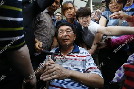 Stock Image of Former Taiwanese President Chen Shui-bian (c) is Escorted by Relatives As Supporters Mobbed Him Before Attending an Event in Taipei Taiwan 04 June 2016 Chen who was Jailed For Corruption Made His First Public Appearance Since He was Granted a Medical Parole in January Last Year Taiwan Taipei