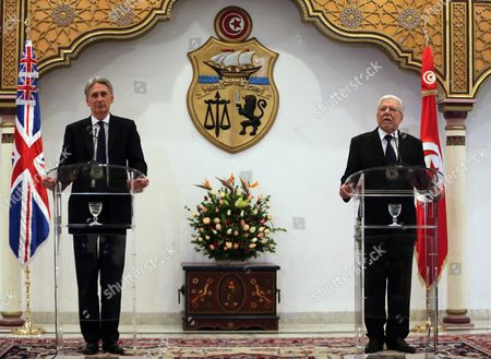 British Foreign Secretary Philip Hammond (l) Speaks During a Joint Press Conference with His Tunisia Counterpart Taieb Baccouche (r) at the Ministry of Foreign Affairs in Tunis Tunisia 27 November 2015 Philip Hammond's Visit is Part of 'Britain's Full Commitment to Supporting Tunisia in This Critical Phase to Back Its Counter-terrorism Efforts ' the Ministry of Foreign Affairs Said Tunisia Tunis