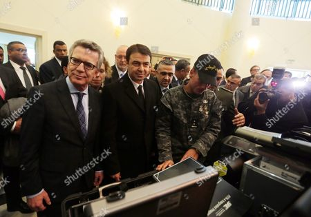 German Interior Minister Thomas De Maiziere (l) and His Tunisian Counterpart Hedi Majdoub (2-l) Inspect Equipment Offered by Germany at a National Guard Barracks in Tunis Tunisia 01 March 2016 the Equipment was Made Available to Help Tunisia Monitor Its Borders Along with Libya Tunisia Tunis