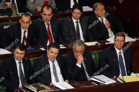 (r-l Bottom) Tunisian Prime Minister Habib Essid Along with Tunisian Justice Minister Amor Mansour Defence Minister Farhat Horchani Interior Minister Hedi Majdoub Along with Other Unidentified Members Attend a Plenary Session of the House of People's Representatives (hpr) in Tunis Tunisia 27 January 2016 During His Speech Before the Deputies of the Arf Habib Essid Said 'There Have Been Three Attacks in Tunisia the Situation Would Have Been Better if There Had Been No Such Attacks Also the Situation in Libya Heavily Impacted Us ' Tunisia Tunis