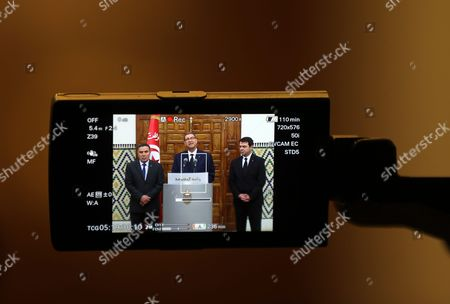 Tunisian Defense Minister Farhat Horchani (l) Tunisian Prime Minister Habib Essid (c) and Tunisia Interior Minister Hedi Majdoub (r) Are Seen on a Camera Screen During a Press Conference After an Emergency Cabinet Meeting in Tunis Tunisia 08 March 2016 the Death Toll From Clashes Between Tunisian Security Forces and Unidentified Insurgents Near the Border with Libya is 54 the Interior Ministry Said a Day Earlier the Clashes Broke out when Gunmen Attempted to Storm Military and Security Barracks and Other Sites at Dawn Monday in Begardene Near the Libyan Border Tunisia Has Experienced a Series of Deadly Attacks During the Past Year the Islamic State Terrorist Group Which is Active in Libya Has Claimed Responsibility For Some of the Attacks Including a Shooting Spree That Killed 21 Tourists and a Police Officer at the Bardo Museum in the Heart of Tunis Tunisia Tunis