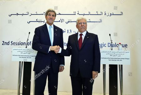 Tunisia Foreign Minister Taieb Baccouche (r) Shakes Hands with the Us Secretary of State John Kerry (l) in Tunis Tunisia 13 November 2015 Kerry is in Tunisia to Take Part in Talks with the Wide Ranging Tunisian National Dialogue Quartet to Look at Ways of Improving Political and Economic Ties with the Small North African Nation Tunisia Tunis