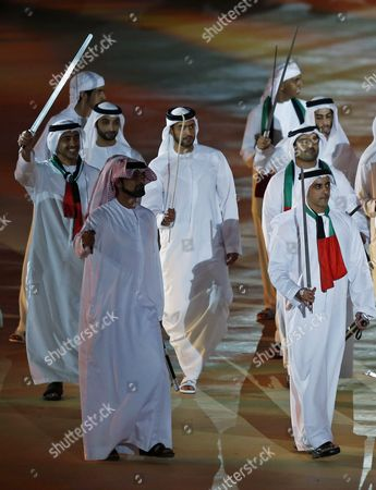 Hh Sheikh Abdullah Bin Zayed Bin Sultan Al-nahyan (l) the United Arab Emirates Minister of Foreign Affairs and Lieutenant General Sheikh Saif Bin Zayed Al-nahyan (r) Deputy Prime Minister and Minister of Interior and Vice Chairman of the Emirates Identity Authority Perform a Traditional Dance During Celebrations of the Uae's 44th National Day at the Sheikh Zayed Sports City Stadium in Abu Dhabi United Arab Emirates 02 December 2015 Uae Citizens an Residents Celebrate National Day 02 December Marking the Unification of the Seven Emirates Abu Dhabi Dubai Sharjah Fujairah Ras Al-khaimah Ajman and Umm Al-quwain Into the United Arab Emirates and Freedom From the British Protectorate United Arab Emirates Abu Dhabi