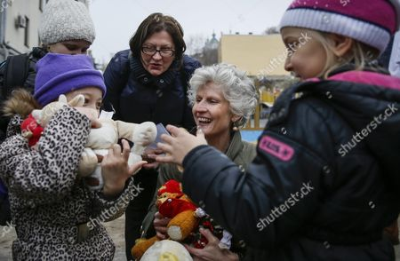 A Member of the European Parliament Anna Maria Corazza Bildt From Sweden (c) Gives Toys to Children During a Visit to the Center For Distribution of Humanitarian Aid For Internally Displaced Persons From Eastern Ukraine and Crimea in Kiev Ukraine 05 November 2015 Members of the European Parliament Delivered Humanitarian Aid Which Contained Clothes and Toys For Children to the Center Ukraine Kiev