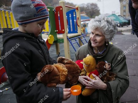 A Member of the European Parliament Anna Maria Corazza Bildt From Sweden Gives Toys to a Child During a Visit to the Center For Distribution of Humanitarian Aid For Internally Displaced Persons From Eastern Ukraine and Crimea in Kiev Ukraine 05 November 2015 Members of the European Parliament Delivered Humanitarian Aid Which Contained Clothes and Toys For Children to the Center Ukraine Kiev