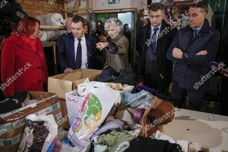 Members of the European Parliament Anna Maria Corazza Bildt From Sweden (c) Andrej Plenkovic From Croatia (2-r) Petras Aushtryavichus From Lithuania (r) and Other Members of the European Parliament Visit the Center of Distribution of Humanitarian Aid For Internally Displaced Persons From Eastern Ukraine and Crimea in Kiev Ukraine 05 November 2015 Members of the European Parliament Delivered Humanitarian Aid Which Contained Clothes and Toys For Children to the Center Ukraine Kiev