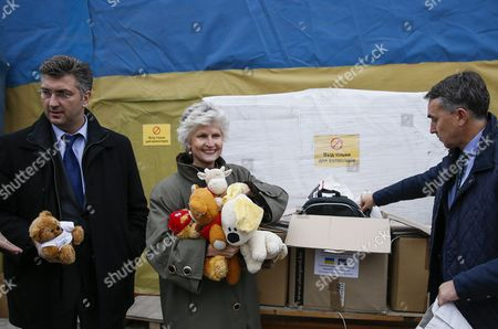 Members of the European Parliament Anna Maria Corazza Bildt From Sweden (c) Andrej Plenkovic From Croatia (l) Petras Aushtryavichus From Lithuania (r) Together with Other Members of the European Parliament Visit the Center of Distribution of Humanitarian Aid For Internally Displaced Persons From Eastern Ukraine and Crimea in Kiev Ukraine 05 November 2015 Members of the European Parliament Delivered Humanitarian Aid Which Contained Clothes and Toys For Children to the Center of Distribution of Humanitarian Aid For Internally Displaced Persons From Eastern Ukraine and Crimea Ukraine Kiev