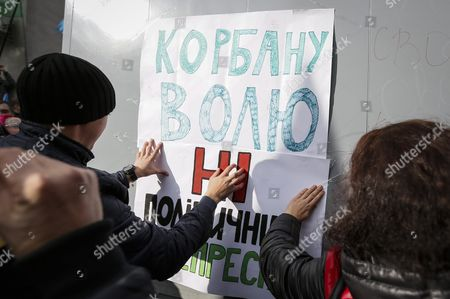 Stock Image of Supporters of Ukrainian Party 'Ukrop' Attach to a Prisoner Transport Vehicle a Banner Reading 'Freedom For Korban No Political Repression' As They Protest Against the Arrest of Gennadiy Korban in Front of the Security Service of Ukraine (sbu) Building in Kiev Ukraine 03 November 2015 the Leader of the Ukrainian Party 'Ukrop' and Former Deputy Governor of Dnipropetrovsk Gennadiy Korban was Arrested in Dniptopetrovsk on 31 October 2015 on Suspicion of Organizing a Criminal Group According to the Prosecutor General's Office of Ukraine Ukraine Kiev