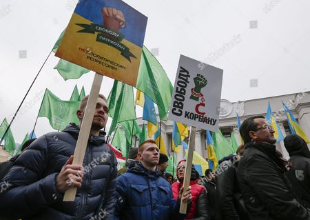 Supporters of Ukrainian Party 'Ukrop' Hold Banners Reading 'Freedom For Korban' and 'Freedom For Patriots' As They Protest Against Arresting of Gennadiy Korban in Front of the Ukrainian Parliament in Kiev Ukraine 03 November 2015 the Leader of the Ukrainian Party 'Ukrop' and Former Deputy Governor of Dnipropetrovsk Gennadiy Korban was Arrested in Dniptopetrovsk on 31 October 2015 on Suspicion of Organizing a Criminal Group According to the Prosecutor General's Office of Ukraine Ukraine Kiev