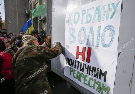 Stock Picture of Supporters of Ukrainian Party 'Ukrop' Attach to a Prisoner Transport Vehicle a Banner Reading 'Freedom For Korban No Political Repression' As They Protest Against Arresting of Gennadiy Korban in Front of the Security Service of Ukraine (sbu) Building in Kiev Ukraine 03 November 2015 the Leader of the Ukrainian Party 'Ukrop' and Former Deputy Governor of Dnipropetrovsk Gennadiy Korban was Arrested in Dniptopetrovsk on 31 October 2015 on Suspicion of Organizing a Criminal Group According to the Prosecutor General's Office of Ukraine Epa/roman Pilipey Ukraine Kiev