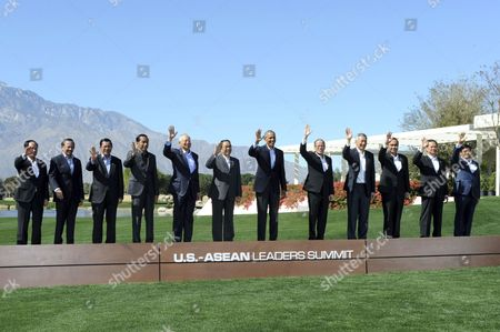 Us President Barack Obama (c) Waves Along with Asean Leaders As They Pose For a Group Photo on the Second Day of the Us-asean Summit at Sunnylands in Rancho Mirage California Usa 16 February 2016 in Picture (l-r) Asean's Secretary General Le Luong Minh Brunei's Sultan Hassanal Bolkiah Cambodia's Prime Minister Hun Sen Indonesia's President Joko Widodo Malaysia's Prime Minister Najib Razak Laos' President Choummaly Sayasone Philippines' President Benigno Aquino Iii Singapore's Prime Minister Lee Hsien Loong Thailand's Prime Minister Prayuth Chan-ocha Vietnam's Prime Minister Nguyen Tan Dung and Myanmar's Vice President Nyan Tun the Us is Hosting a Meeting with Leaders From the Association of South-east Asian Nations (asean) For the First Time Amid Growing Tensions with China Over a Maritime Territorial Dispute United States Rancho Mirage