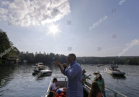 Stock Image of Senior Pastor Jeremy Lawson of Clayton First United Methodist Church Delivers His Sermon During Lake Rabun Boat Church in Lakemont Georgia Usa 26 July 2015 Since 1972 Clayton First United Methodist Church Has Been Conducting the Floating Services on Summer Sunday Mornings on the North Georgia Mountain Lake From Memorial Day (30 May) Through Labor Day (first Monday of September) People who Live Or Visit the Lake Can Attend the Services on Their Boats Or Listen From the Shore United States Lakemont