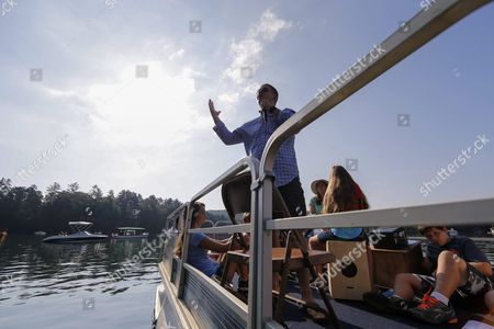 Stock Photo of Senior Pastor Jeremy Lawson of Clayton First United Methodist Church Delivers His Sermon During Lake Rabun Boat Church in Lakemont Georgia Usa 26 July 2015 Since 1972 Clayton First United Methodist Church Has Been Conducting the Floating Services on Summer Sunday Mornings on the North Georgia Mountain Lake From Memorial Day (30 May) Through Labor Day (first Monday of September) People who Live Or Visit the Lake Can Attend the Services on Their Boats Or Listen From the Shore United States Lakemont