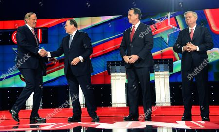 Us Republican Presidential Candidates George Pataki (l) Shakes Hands with Mike Huckabee (2l) As Rick Santorum (2r) and Lindsey Graham (r) Stand on Stage Prior to Their Debate at the Venetian Las Vegas in Las Vegas Nevada Usa 15 December 2015 United States Las Vegas